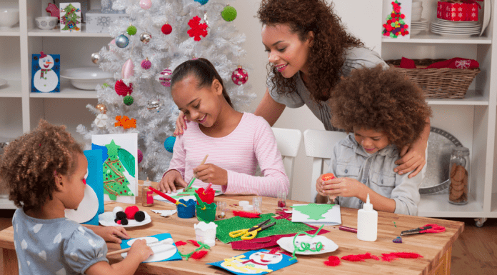 family making Christmas crafts together