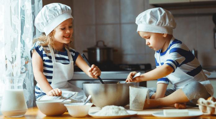 2 children baking in the kitchen